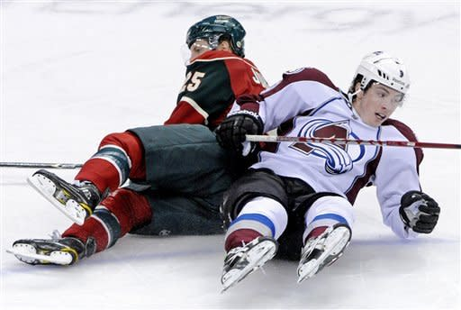 Minnesota Wild's Nick Johnson, left, and Colorado Avalanche's Matt Duchene hit the ice after a collision in the first period of an NHL hockey game Thursday, Nov. 17, 2011, in St. Paul, Minn. (AP Photo/Jim Mone)