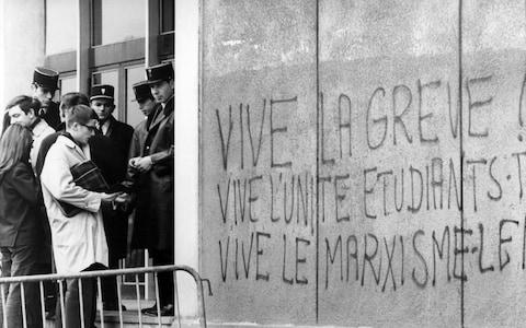 """Graffiti at Nanterre University, near Paris, in 1968 reads """"Long live the strike, Long live student-worker unity, Long live Marxism"""" - Credit: AFP/Getty Images"""