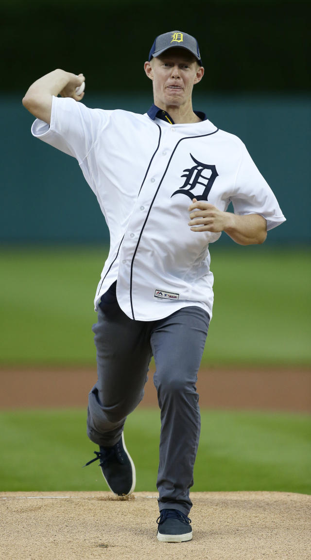 Jimmy Kerr, who played for the Michigan team which reached the finals of the College World Series, throws out a ceremonial first pitch before the Detroit Tigers' baseball game against the Baltimore Orioles on Friday, Sept. 13, 2019, in Detroit. (AP Photo/Duane Burleson)
