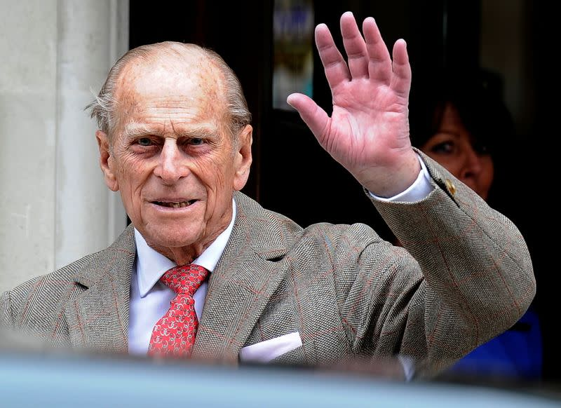 FILE PHOTO: Britain's Prince Philip waves to members of the media as he leaves the King Edward VII Hospital in London