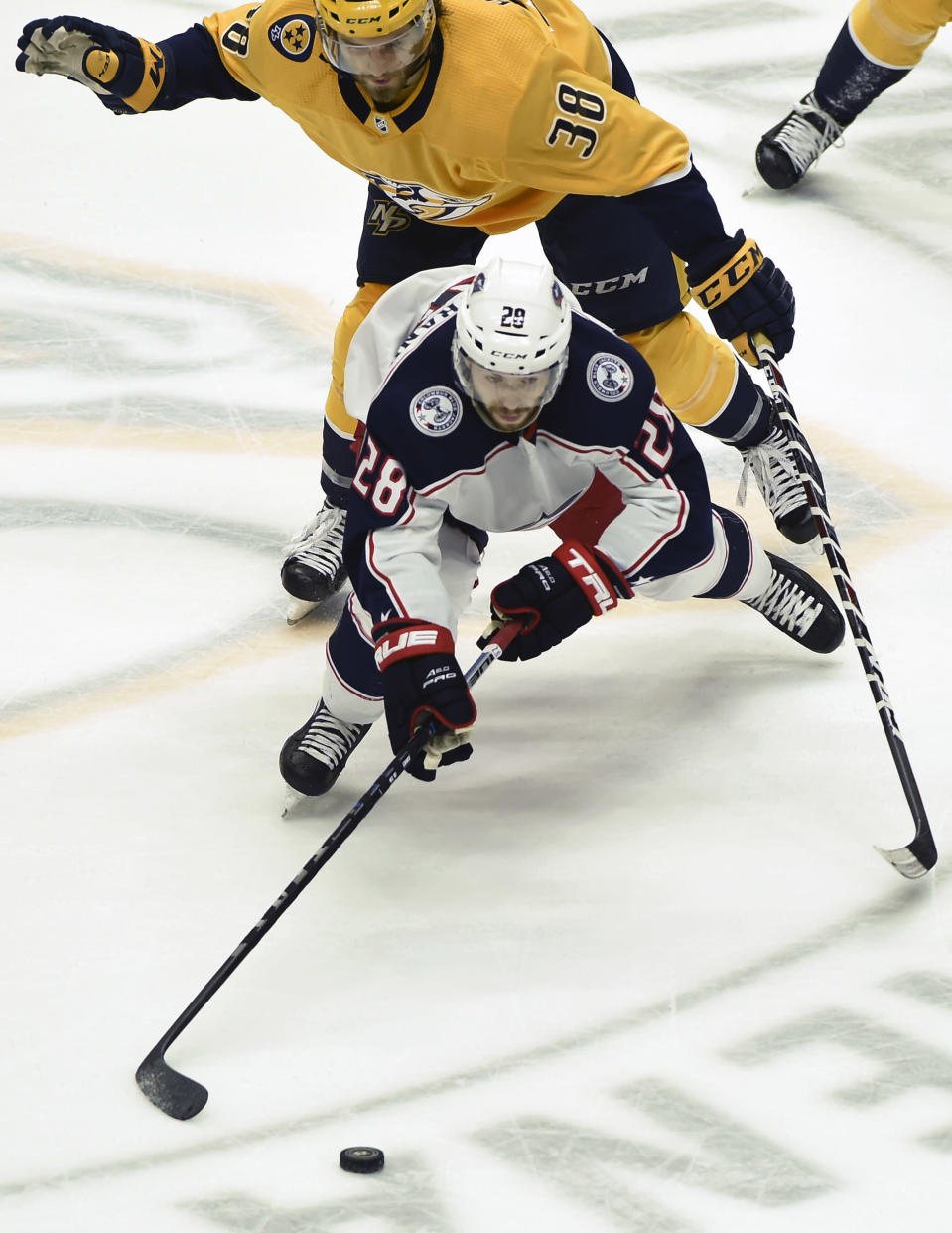 Columbus Blue Jackets right wing Oliver Bjorkstrand (28), of Denmark, maneuvers the puck in front of Nashville Predators right wing Ryan Hartman (38) during the second period of an NHL hockey game Saturday, April 7, 2018, in Nashville, Tenn. (AP Photo/Mark Zaleski)