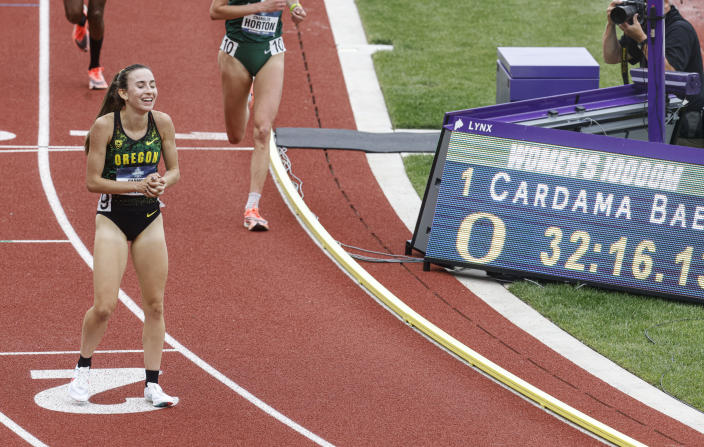 Oregon's Carmela Cardama Baez slows after wining the women's 10,000 meters at the NCAA Division I Outdoor Track and Field Championships, Thursday, June 10, 2021, at Hayward Field in Eugene, Ore. (AP Photo/Thomas Boyd)