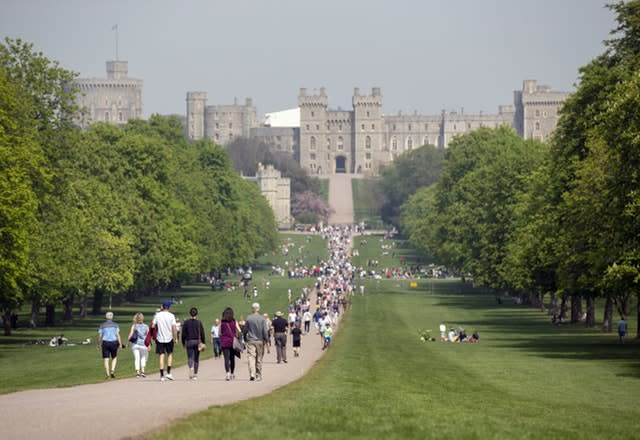 People enjoy the sunshine on the Long Walk in Windsor