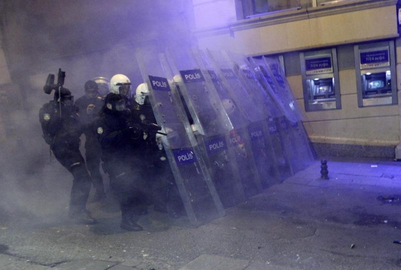 Riot police take positions as they clash with demonstrators during a protest against internet censorship in Istanbul