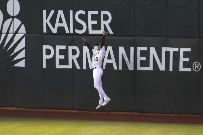 Oakland Athletics' Stephen Piscotty catches a fly ball hit by Tampa Bay Rays' Brandon Lowe during the seventh inning of a baseball game in Oakland, Calif., Friday, May 7, 2021. (AP Photo/Jed Jacobsohn)