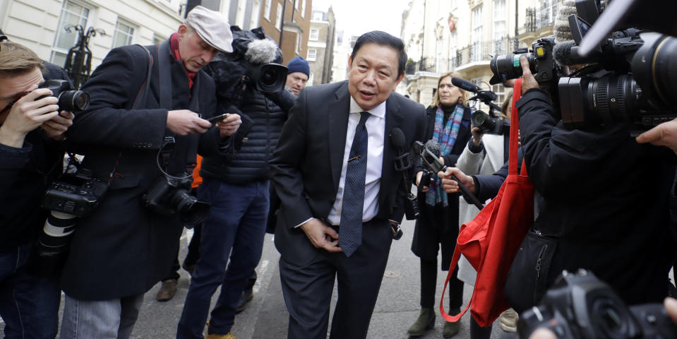 "Myanmar's ambassador to the UK, Kyaw Zwar Minn is surrounded by media as he arrives outside the Myanmar Embassy in London, Thursday, April 8, 2021. Myanmar's ambassador to the UK, Kyaw Zwar Minn said on Thursday his country's military has occupied the London embassy and threatened its staff with ""severe punishment"" if they do not work with the Junta. (AP Photo/Kirsty Wigglesworth)"