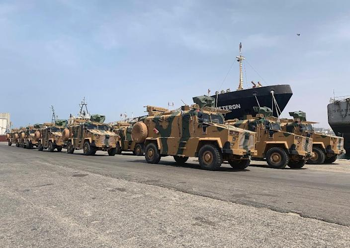 """A photo posted on the Facebook Page of the media bureau of """"Volcano of Anger"""" operation on May 18, 2019, reportedly shows Turkish-made armoured personnel vehicles, shipped to Libya's internationally recognised Government of National Accord (GNA), arriving at Tripoli port.GNA forces are currently battling fighters from commander Khalifa Haftar's self-styled Libyan National Army, which launched an offensive on April 4 to take the capital. The GNA said the new weaponry had been supplied """"in preparation for a vast operation to annihilate the rebels of the war criminal, the rebel Haftar."""" (AFP Photo/-)"""