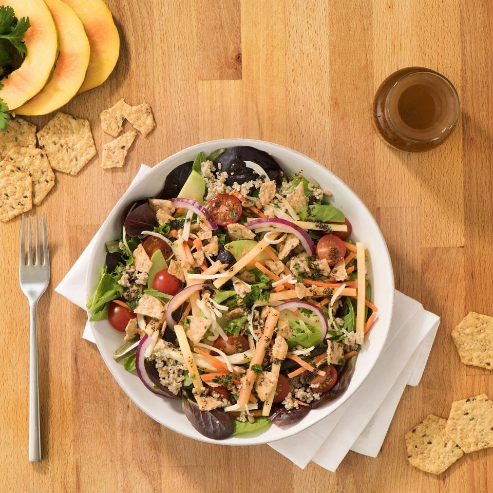 """<p>This super-satisfying salad gets a whole-grain boost from cooked quinoa and crumbled whole-grain crackers. <a href=""""http://www.eatingwell.com/recipe/261141/quinoa-cilantro-taco-salad/"""" rel=""""nofollow noopener"""" target=""""_blank"""" data-ylk=""""slk:View recipe"""" class=""""link rapid-noclick-resp""""> View recipe </a></p>"""