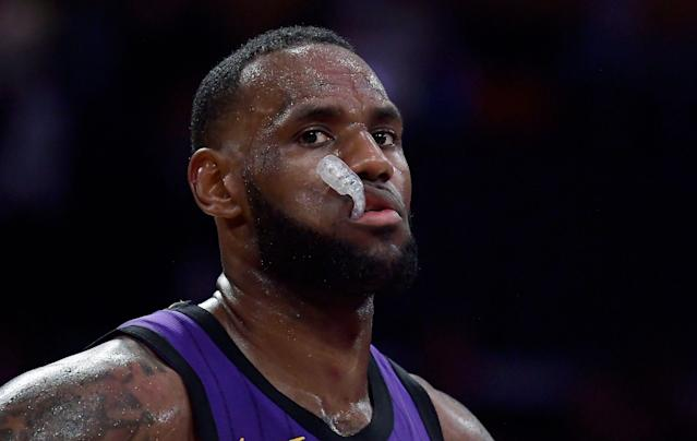 Los Angeles Lakers forward LeBron James paues during the closing seconds of the team's NBA basketball game against the Milwaukee Bucks on Friday, March 1, 2019, in Los Angeles. The Bucks won 131-120. (AP Photo/Mark J. Terrill)