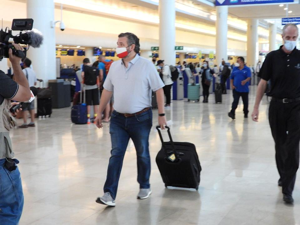 Sen. Ted Cruz (R-Texas) checks in for a flight at Cancun International Airport on Feb. 18, 2021, after backlash over his family vacation. (Photo: MEGA/GC Images/Getty Images)