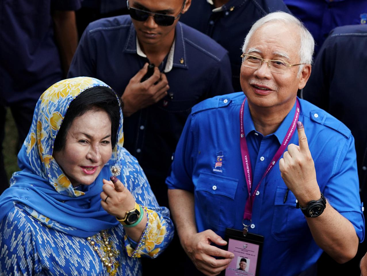 FILE PHOTO: Malaysia's Prime Minister Najib Razak of Barisan Nasional (National Front) and his wife Rosmah Mansor show their ink-stained fingers after voting in Malaysia's general election in Pekan, Pahang, Malaysia, May 9, 2018. REUTERS/Athit Perawongmetha/File Photo