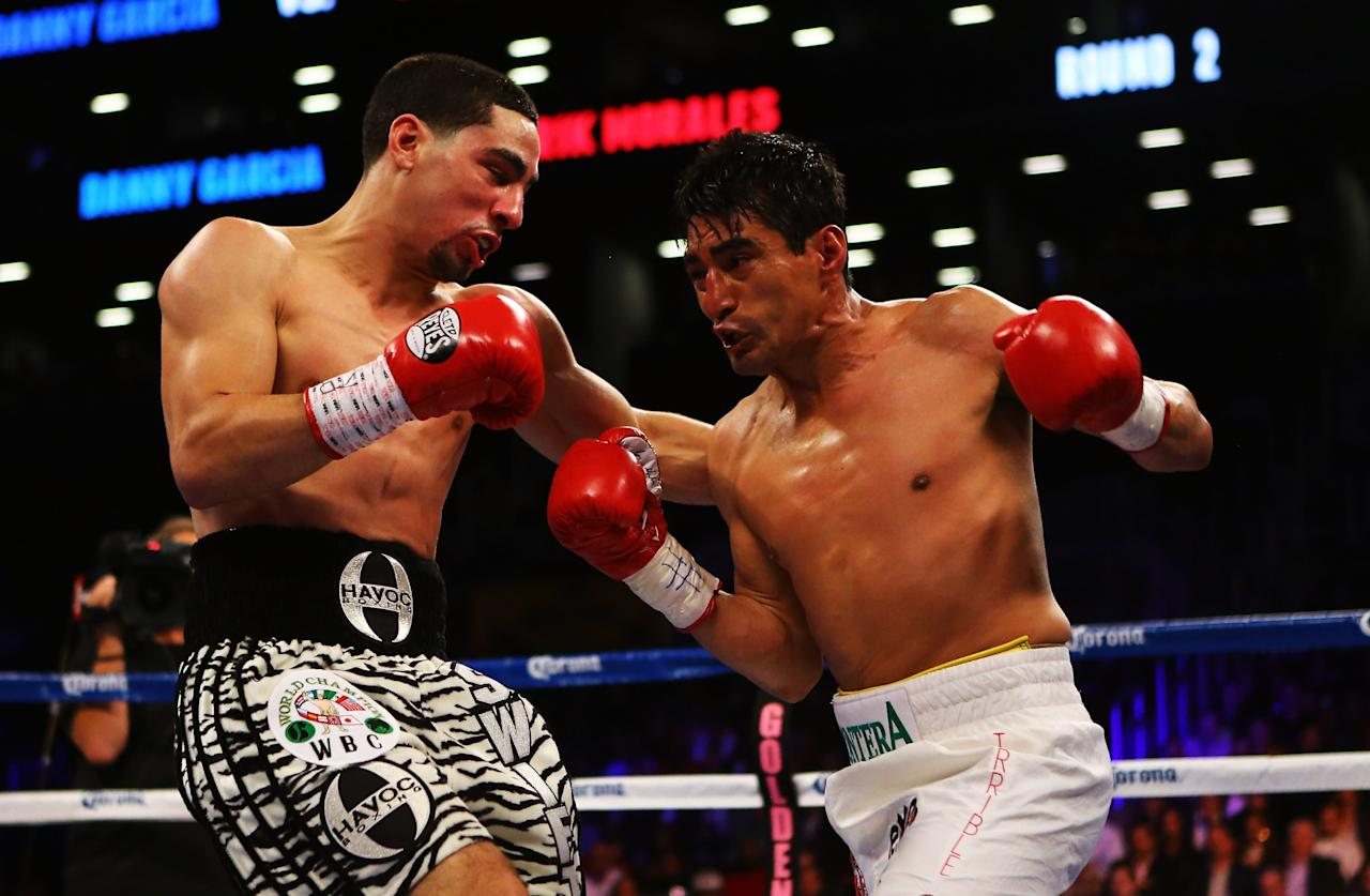 NEW YORK, NY - OCTOBER 20:  Danny Garcia and Erik Morales exchange punches during their WBC/WBA junior welterweight title at the Barclays Center on October 20, 2012 in the Brooklyn Borough of New York City.  (Photo by Al Bello/Getty Images for Golden Boy Promotions)