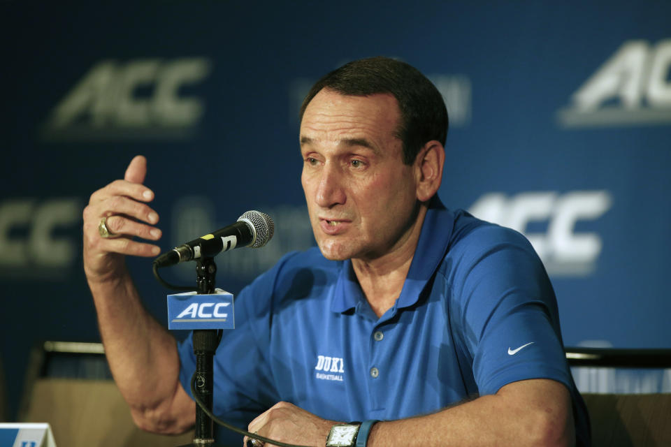Duke coach Mike Krzyzewski answers a question at the Atlantic Coast Conference NCAA college basketball media day in Charlotte, N.C., Wednesday, Oct. 29, 2014. (AP Photo/Nell Redmond)