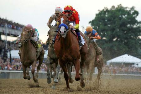 FILE PHOTO: Justify with jockey Mike Smith aboard wins the 150th running of the Belmont Stakes, the third leg of the Triple Crown of Thoroughbred Racing at Belmont Park in Elmont, New York, U.S., June 9, 2018. REUTERS/Mike Segar/File Photo