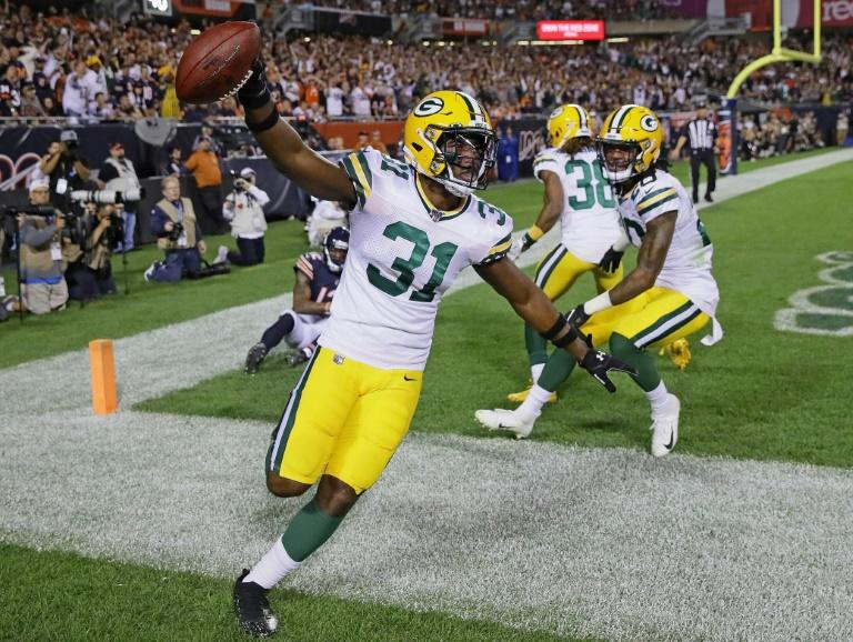 Green Bay's Adrian Amos celebrates after intercepting a pass in the end zone over Chicago's Allen Robinson in the Packers' 10-3 NFL victory over the Bears at Soldier Field