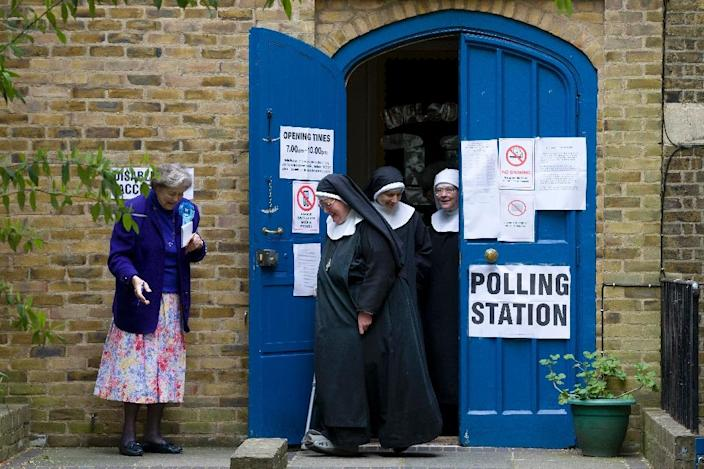 Nuns leave a polling station after voting in London on May 7, 2015 as Britain holds a general election (AFP Photo/Justin Tallis)