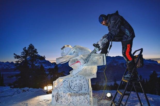 Calgarian Scott Harrison works on his ice sculpture, Rocky Mountain Blades, which is entered in the national competition Winterlude. This year, the public will vote for the winner.