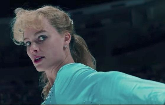 She sports a teal coloured leotard and tights as she glides across the ice in the new trailer. Source: Neon