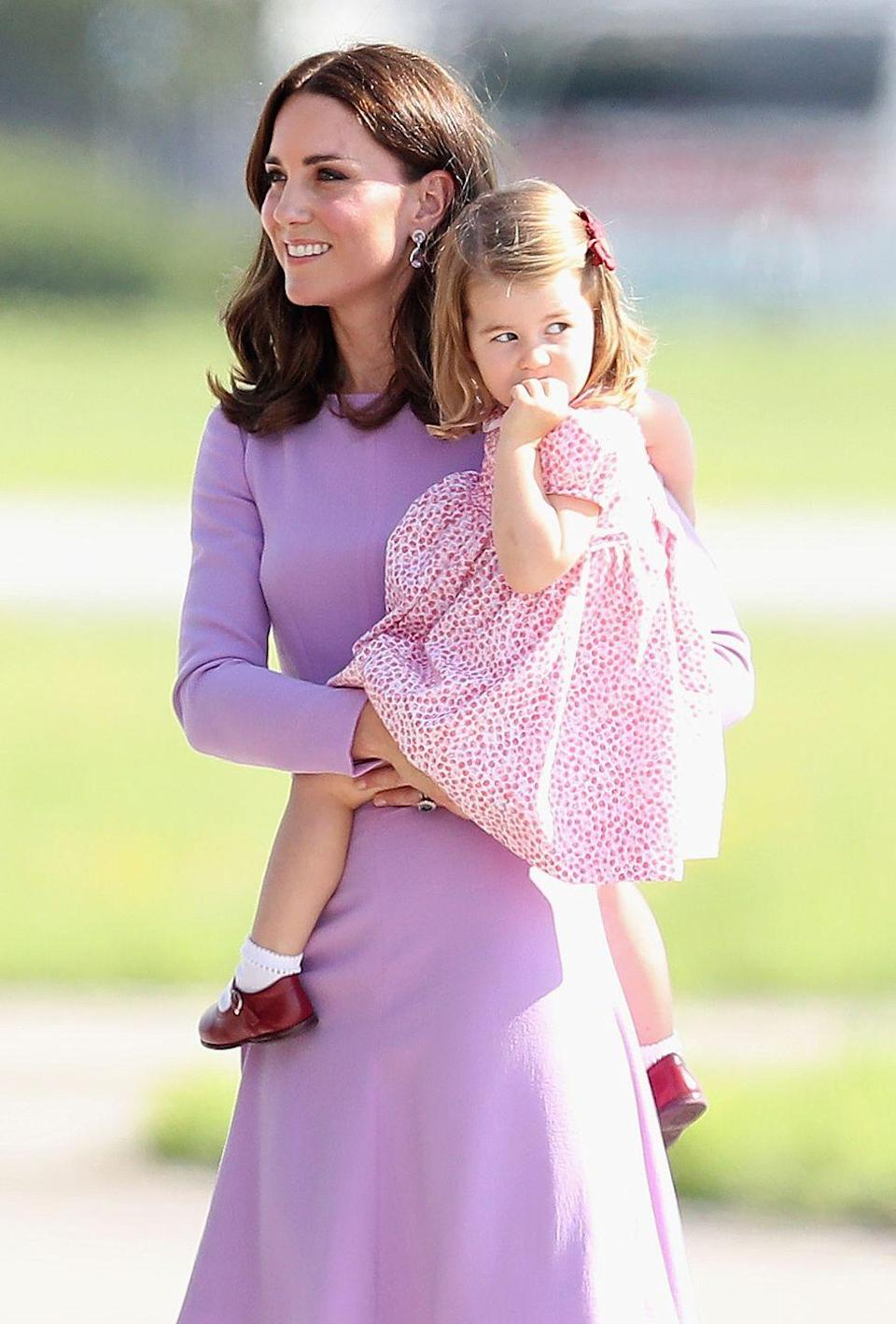 <p>Kate chose a lavender number from Emilia Wickstead for her final day in Germany. She paired the look with nude pumps and a bright red clutch.</p>