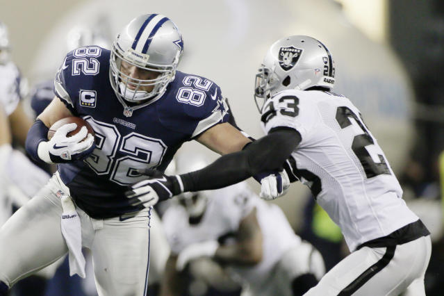 Dallas Cowboys tight end Jason Witten (82) is tackled by Oakland Raiders cornerback Tracy Porter (23) during the first half of an NFL football game, Thursday, Nov. 28, 2013, in Arlington, Texas. (AP Photo/Tim Sharp)