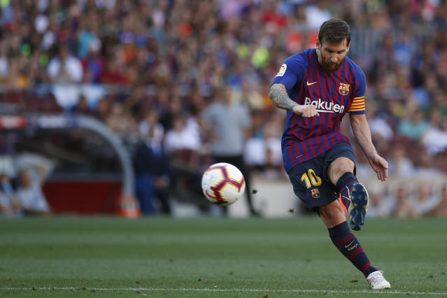 Barcelona's Leo Messi takes a free kick, during a Spanish La Liga soccer match between Barcelona and Huesca at the Camp Nou stadium in Barcelona, Spain, Sunday Sept. 2, 2018. (AP Photo/Eric Alonso)