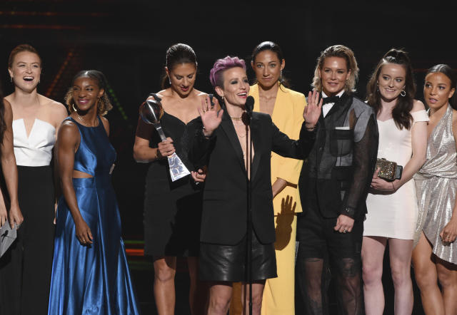 Megan Rapinoe, center, and members of the U.S. women's national soccer team accept the award for best team at the ESPY Awards on Wednesday, July 10, 2019, at the Microsoft Theater in Los Angeles. (Photo by Chris Pizzello/Invision/AP)