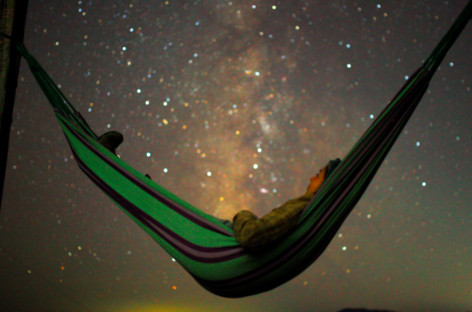 <p>What better way to take in the sights than to lie back in a hammock like this person in Macedonia (Reuters) </p>