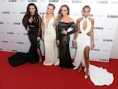 <p>Little Mix looked utterly glamorous in their co-ordinating gowns that all showed off their toned figures with a range of racy cut-outs. <i>[Photo: Rune Hellestad/ Getty Images]</i></p>