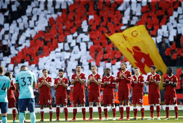 "Soccer Football - Premier League - Liverpool vs AFC Bournemouth - Anfield, Liverpool, Britain - April 14, 2018 Liverpool players during a minutes applause in tribute to the Hillsborough disaster before the match Action Images via Reuters/Carl Recine EDITORIAL USE ONLY. No use with unauthorized audio, video, data, fixture lists, club/league logos or ""live"" services. Online in-match use limited to 75 images, no video emulation. No use in betting, games or single club/league/player publications. Please contact your account representative for further details."