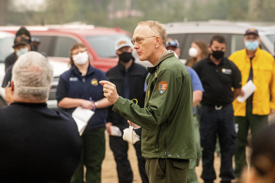 Sequoia and Kings Canyon National Parks Superintendent Clay Jordan speaks with firefighters battling the KNP Complex Fire during a morning briefing in Tulare County, Calif., on Thursday, Sept. 16, 2021. Jordan discussed the need to protect the parks' giant sequoia trees from high-intensity fire in the upcoming days. (AP Photo/Noah Berger)