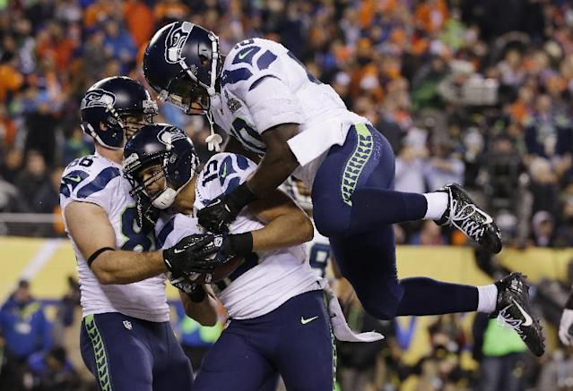 Seattle Seahawks' Jermaine Kearse, center, celebrates with teammate Derrick Coleman, right, after catching a 23-yard touchdown pass during the second half of the NFL Super Bowl XLVIII football game against the Denver Broncos Sunday, Feb. 2, 2014, in East Rutherford, N.J. The Seahawks won 43-8. (AP Photo/Ted S. Warren)