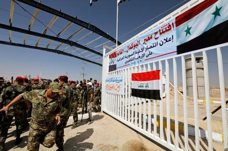 Security forces are seen at the Iraqi-Syrian border, in Al Qaim