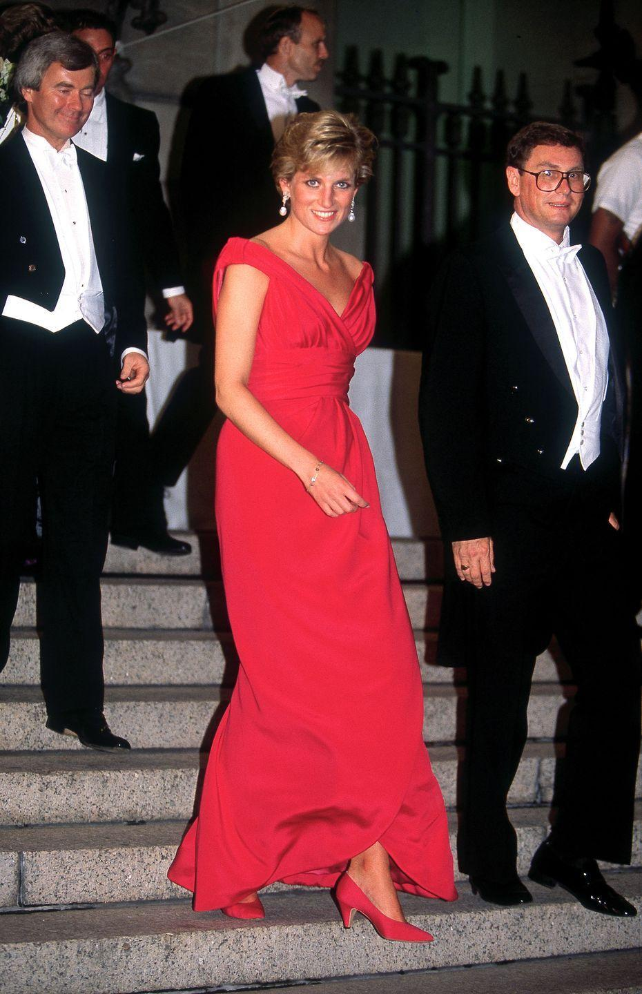 <p>In a red dress by Victor Edelstein at a dinner in Washington, D.C. </p>