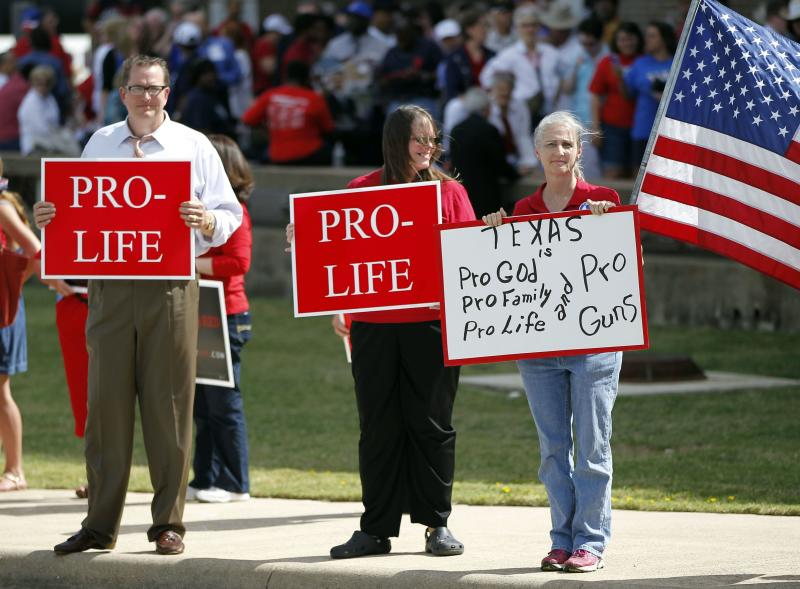 Protesters gather outside W.G. Thomas Coliseum in Haltom City, Texas October 3, 2013, where Wendy Davis, the Texas state senator who staged a filibuster against sweeping abortion restrictions, announced that she would run for governor of the state. REUTERS/Darrell Byers (UNITED STATES - Tags: POLITICS CIVIL UNREST)