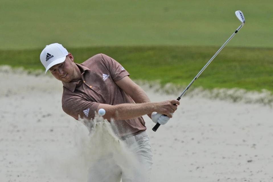 Daniel Berger hits out of the sand on the sixth hole during a practice round at the PGA Championship golf tournament on the Ocean Course Wednesday, May 19, 2021, in Kiawah Island, S.C. (AP Photo/Matt York)