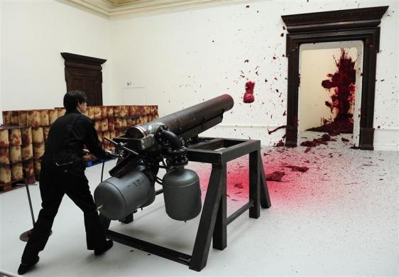 Wax is fired from a sculpture by artist Anish Kapoor called 'Shooting Into The Corner' at the Royal Academy of Arts in London September 22, 2009.