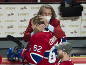 Montreal Canadiens left wing Artturi Lehkonen (62) gets a hug from general manager Marc Bergevin after scoring the winning goal to defeat the Vegas Golden Knights following overtime in Game 6 of an NHL hockey Stanley Cup semifinal playoff series Thursday, June 24, 2021 in Montreal. (Ryan Remiorz/The Canadian Press via AP)
