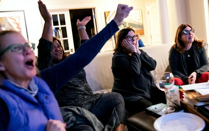 Supporters of Democratic presidential candidate Joe Biden watch election results in Bloomfield Hills, Michigan - AP