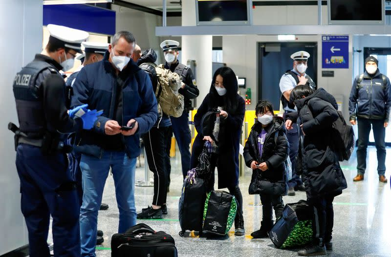 FILE PHOTO: Federal police officers check flight passengers arriving from Britain at Frankfurt Airport