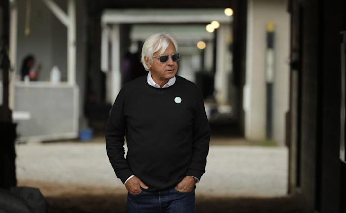 Trainer Bob Baffert looks out from his barn before a workout at Churchill Downs.