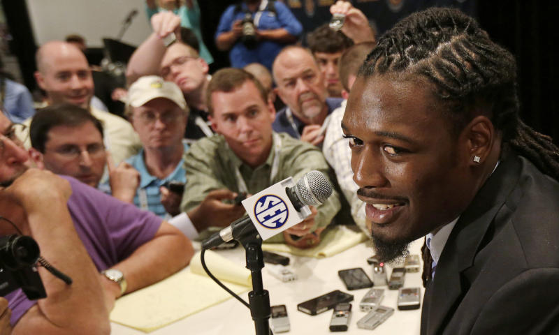 FILE - In this July 16, 2013 file photo, South Carolina's Jadeveon Clowney talks with reporters during the Southeastern Conference football media days in Hoover, Ala. For the next four months, you likely won't be able to escape notice of All-American defensive end Jadeveon Clowney. (AP Photo/Dave Martin, File)