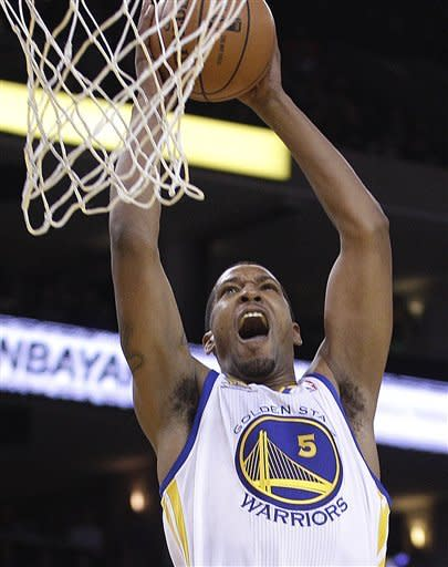 Golden State Warriors' Dominic McGuire scores against the Denver Nuggets during an NBA basketball game Saturday, April 7, 2012, in Oakland, Calif. (AP Photo/Ben Margot)