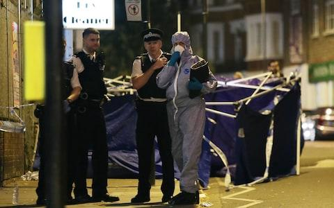 Police at the scene outside Parsons Green Tube station - Credit: Yui Mok/PA