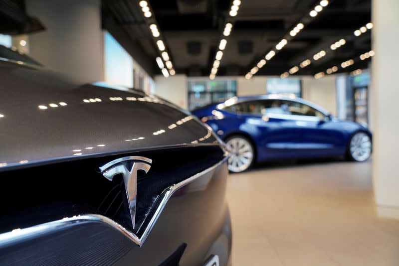 FILE PHOTO: A Tesla logo is seen at a Tesla showroom in Shanghai