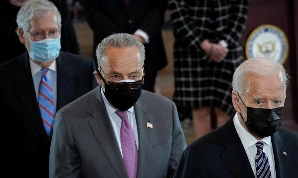 Joe Biden, right, with the Republican and Democratic leaders in the Senate, Mitch McConnell, left, and Chuck Schumer