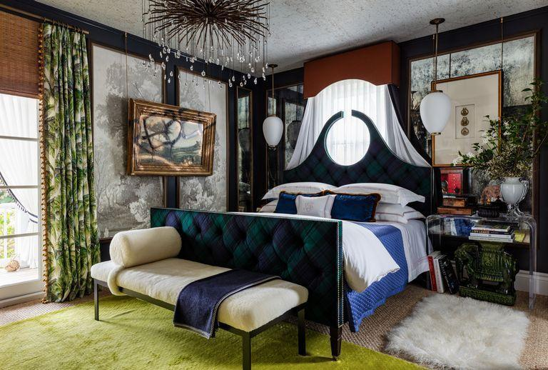 """<p>This statement guest bedroom for the <a href=""""https://www.veranda.com/decorating-ideas/a30641052/kips-bay-decorator-show-house-palm-beach-2020/"""" rel=""""nofollow noopener"""" target=""""_blank"""" data-ylk=""""slk:Kips Bay Showhouse in Palm Beach"""" class=""""link rapid-noclick-resp"""">Kips Bay Showhouse in Palm Beach</a> by <a href=""""https://www.robingannoninteriors.com/"""" rel=""""nofollow noopener"""" target=""""_blank"""" data-ylk=""""slk:Robin Gannon"""" class=""""link rapid-noclick-resp"""">Robin Gannon</a> oozes warmth and richness in an inky laquered black. Mixing a lighter wallpaper with darker molding will make a space feel contained without being small. The bed is upholstered by <a href=""""https://www.mclaughlinupholstering.com/"""" rel=""""nofollow noopener"""" target=""""_blank"""" data-ylk=""""slk:McLaughlin Custom Upholstered Furniture"""" class=""""link rapid-noclick-resp"""">McLaughlin Custom Upholstered Furniture</a>, and the light fixture is <a href=""""https://www.curreyandcompany.com/"""" rel=""""nofollow noopener"""" target=""""_blank"""" data-ylk=""""slk:Currey & Company"""" class=""""link rapid-noclick-resp"""">Currey & Company</a>.</p><p><a class=""""link rapid-noclick-resp"""" href=""""https://www.benjaminmoore.com/en-us/color-overview/find-your-color/color/2129-20/soot?color=2129-20"""" rel=""""nofollow noopener"""" target=""""_blank"""" data-ylk=""""slk:Get the Look"""">Get the Look</a></p>"""