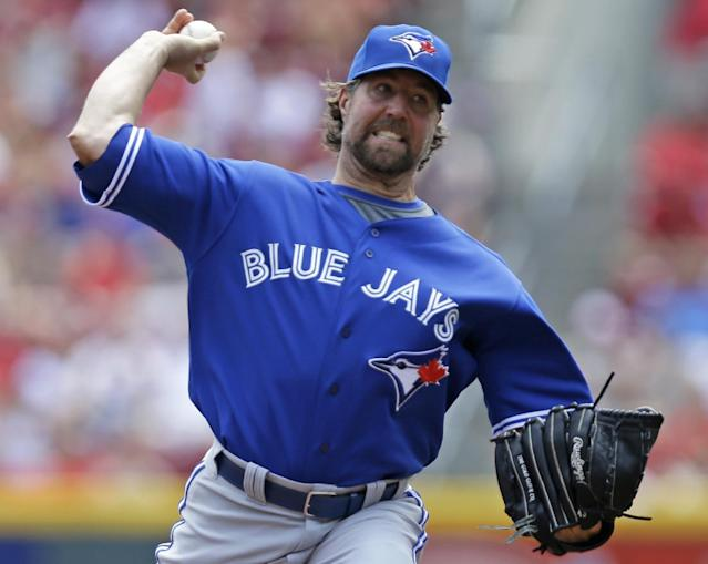 Toronto Blue Jays starting pitcher R.A. Dickey throws against the Cincinnati Reds in the first inning of a baseball game on Sunday, June 22, 2014, in Cincinnati. (AP Photo/Al Behrman)