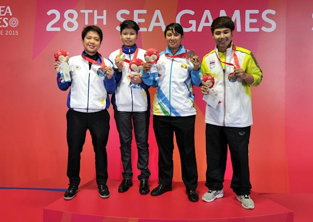 28th SEA Games Singapore 2015 - OCBC Arena Hall - Singapore - 9/6/15 Billiards and Snooker - Womens 9-Ball Singles - Philippines Chezka Centeno celebrates winning gold with Philippines' Rubilen Amit (silver), Myanmar's Aye Mi Aung and Thailands Siraphat Chitchomnart (bronze) SEAGAMES28 Mandatory Credit: Singapore SEA Games Organising Committee / Action Images via Reuters