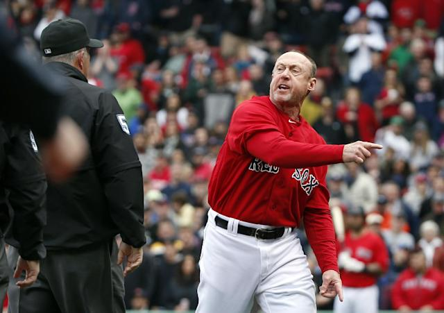 Boston Red Sox third base coach Brian Butterfield argues with umpires after they called Red Sox's Dustin Pedroia out at home plate trying to score on a double by David Ortiz during the seventh inning in the first baseball game of a doubleheader against the Tampa Bay Rays at Fenway Park in Boston, Thursday, May 1, 2014. (AP Photo/Elise Amendola