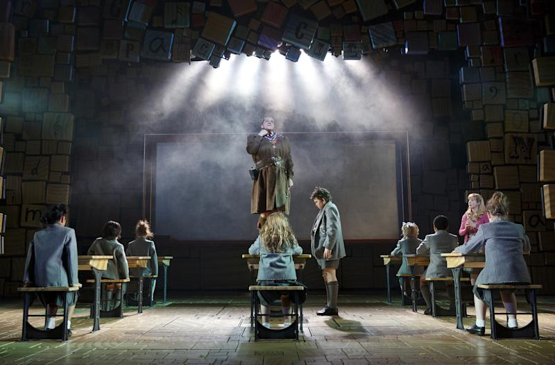 """This theater publicity image released by Boneau/Bryan-Brown shows the cast of """"Matilda, the Musical,"""" including Bertie Carvel, standing center, during a performance in New York. Two Broadway shows with very different audiences broke box office records last week, the kid-friendly """"Matilda, the Musical"""" and the very adult revival of Harold Pinter's """"Betrayal."""" (AP Photo/Boneau/Bryan-Brown, Joan Marcus, File)"""